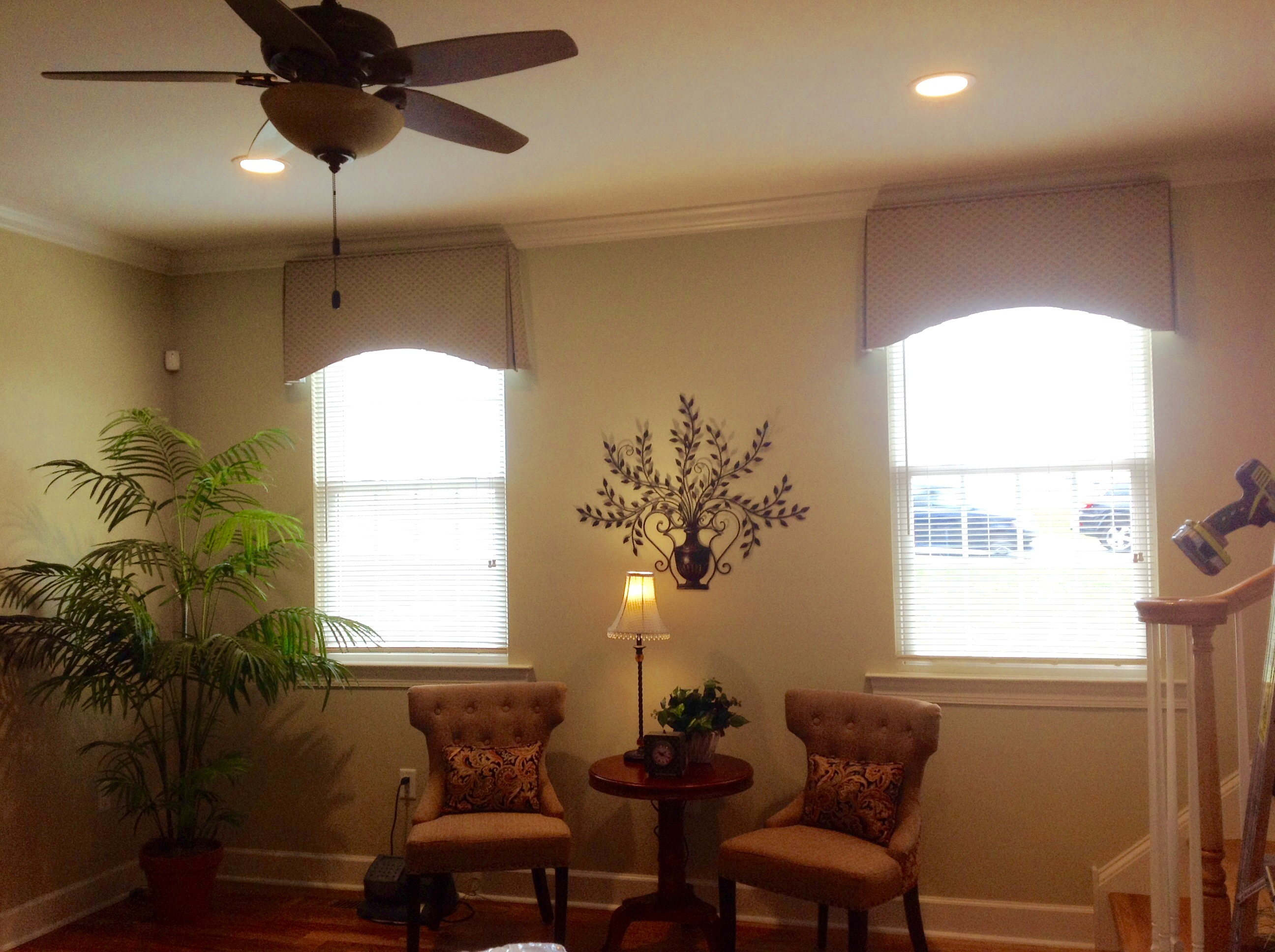 Box pleat arched valances installed ceiling height to elongate and add architectural interest