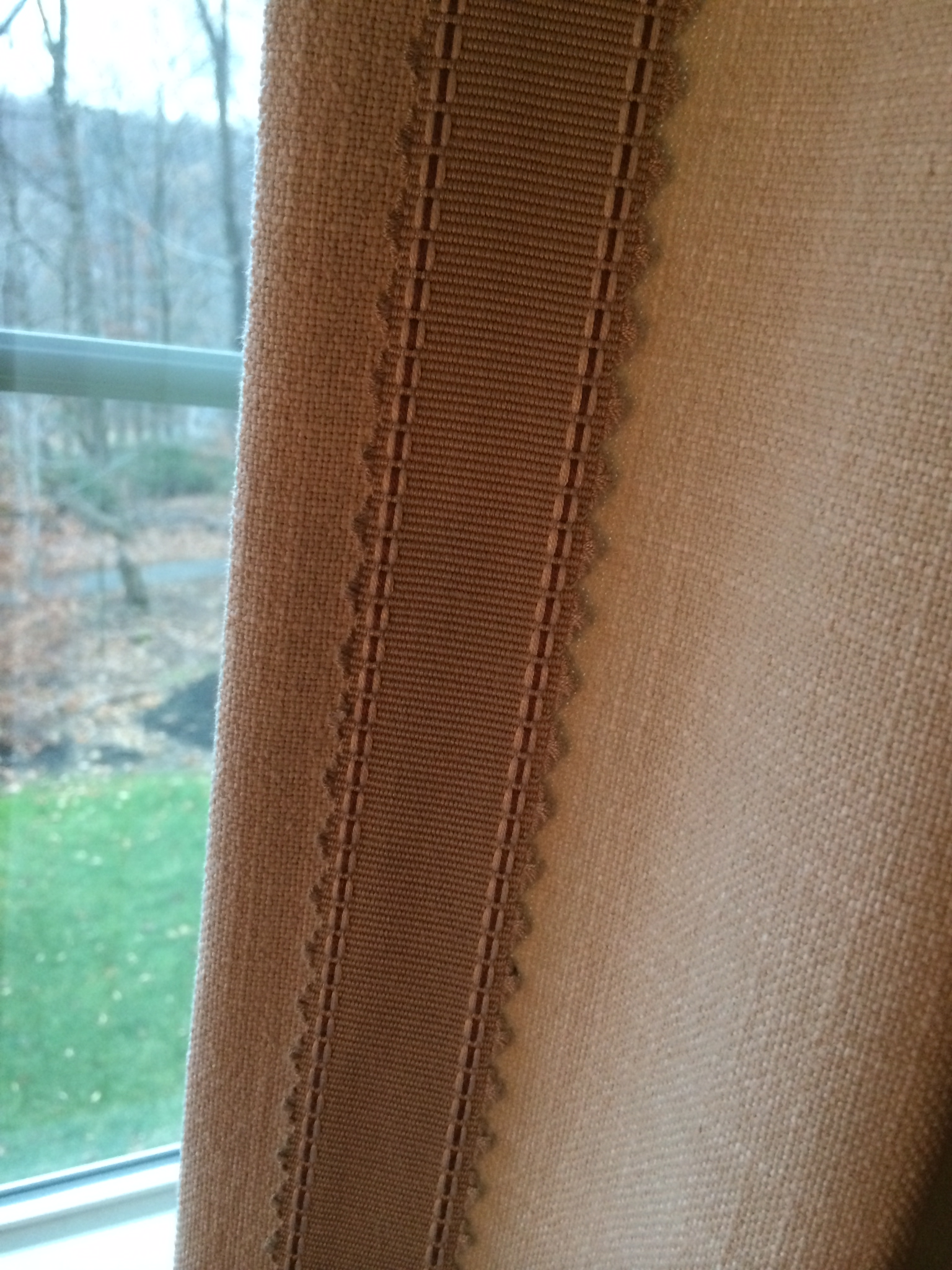 Close up detail of accent banding on drapery