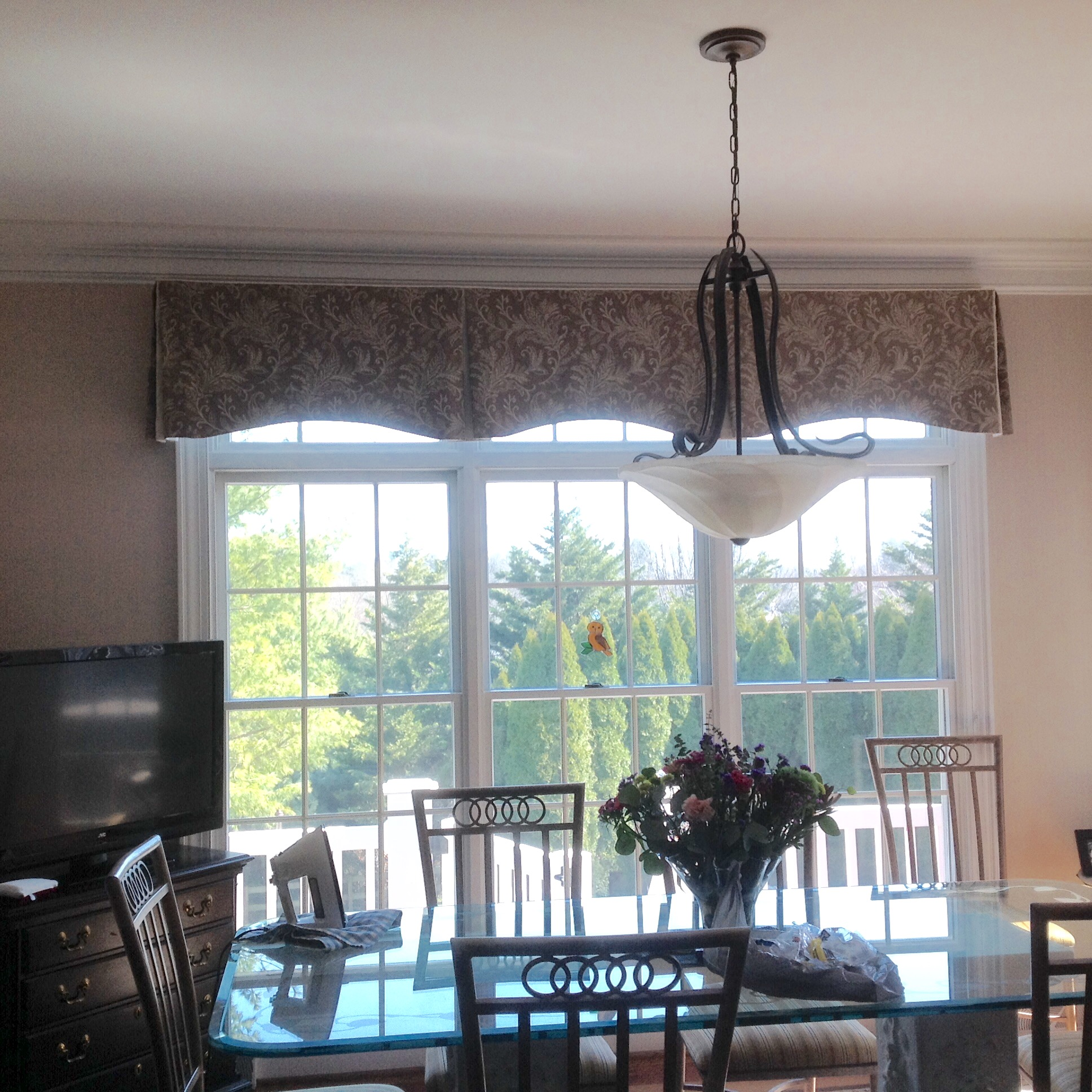 Box pleat arched treatment installed in kitchen dining area