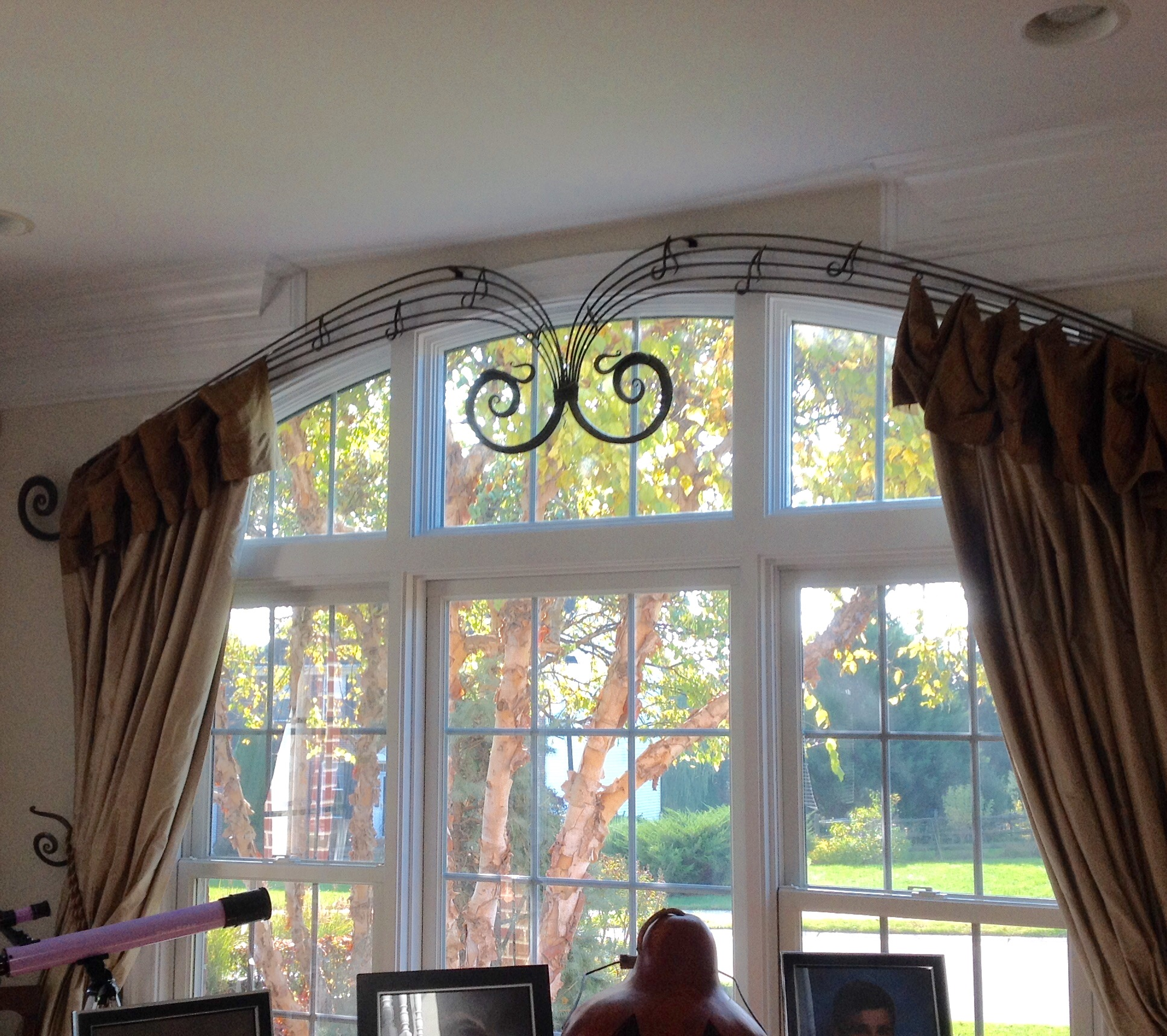 "wrought iron ""musical"" rod with silk panels for piano room"
