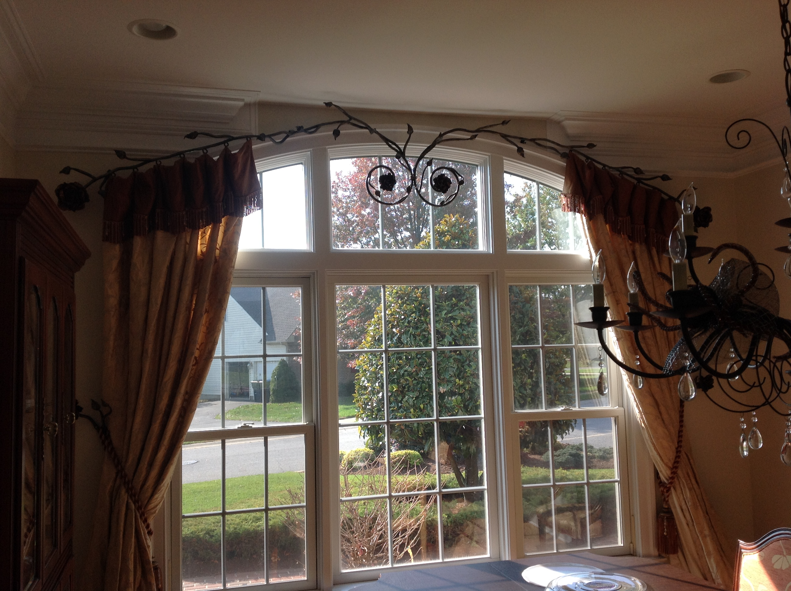"Wrought iron ""floral"" rods with silk panels for dining room"
