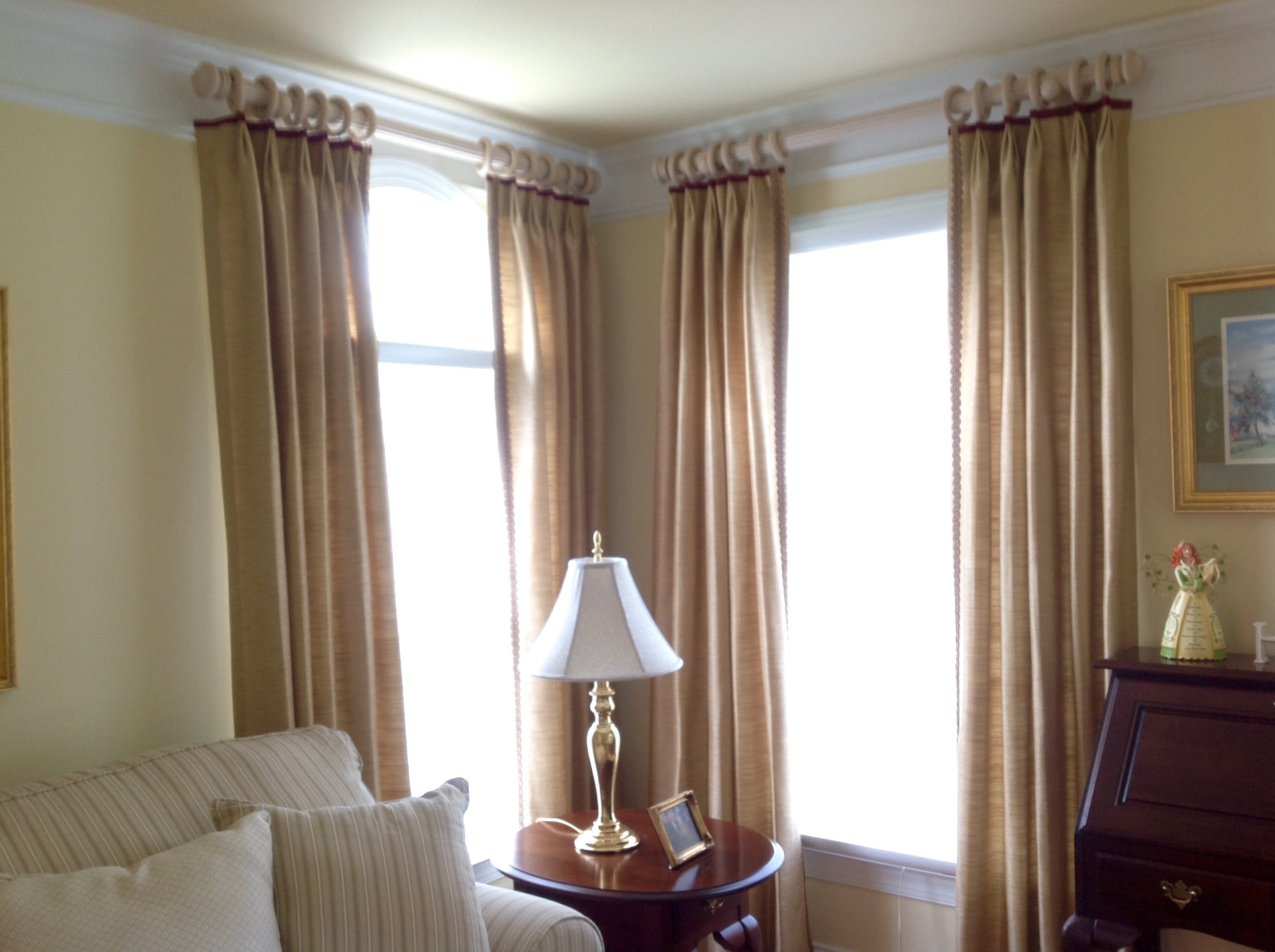 Living Room after removal of swag valances and installation of draperies installed above arches